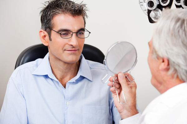 Male in Sandy Springs having his eye checked for a foreign object
